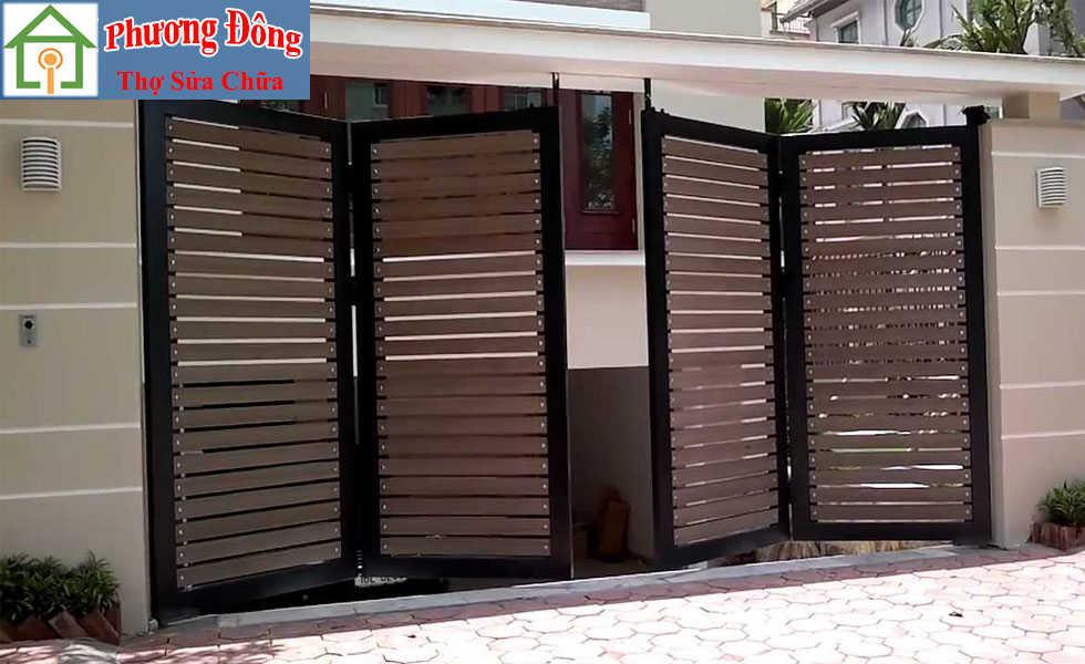 Thợ đang Sơn sửa cửa sắt quận tân phú